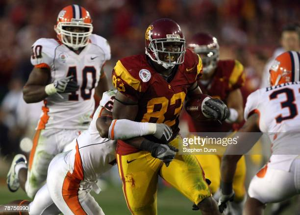 Fred Davis of the USC Trojans runs for yardage after a reception in the second half against Martez Wilson of the Illinois Fighting Illini in the...