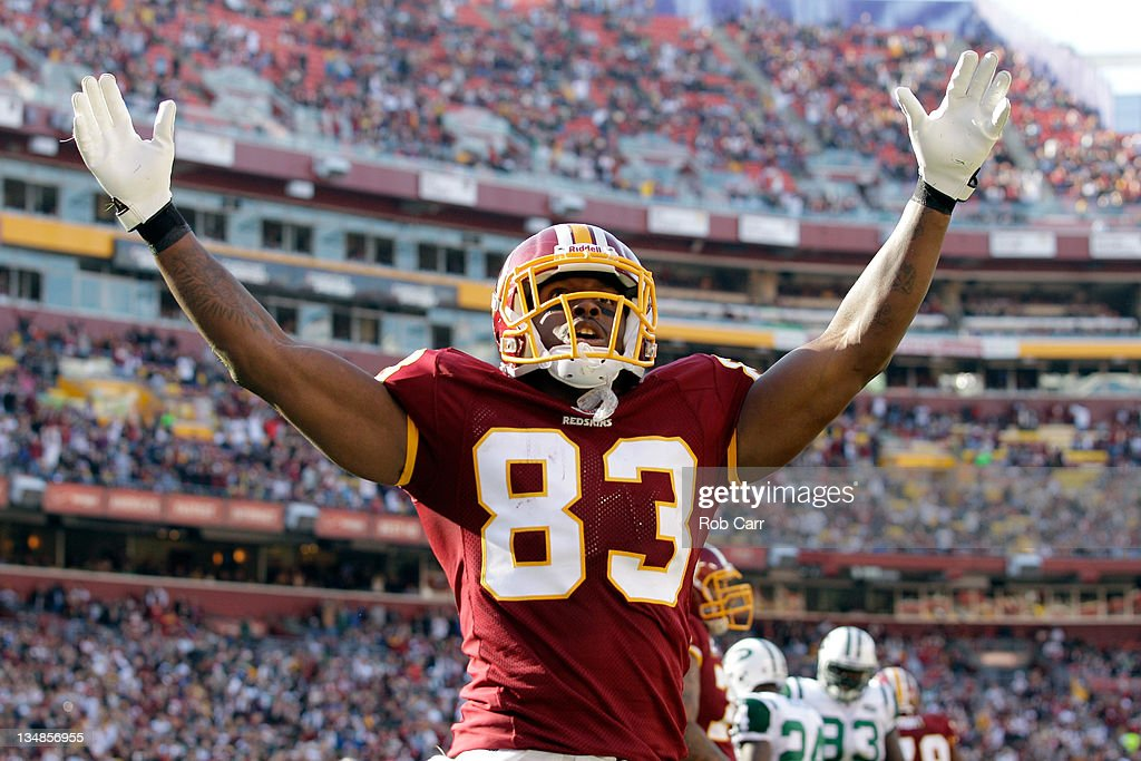 Fred Davis #83 of the Washington Redskins celebrates the Redskins first touchdown against the New York Jets during the first half at FedExField on December 4, 2011 in Landover, Maryland.