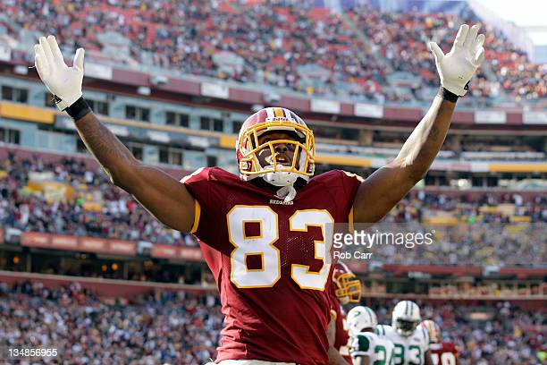Fred Davis of the Washington Redskins celebrates the Redskins first touchdown against the New York Jets during the first half at FedExField on...