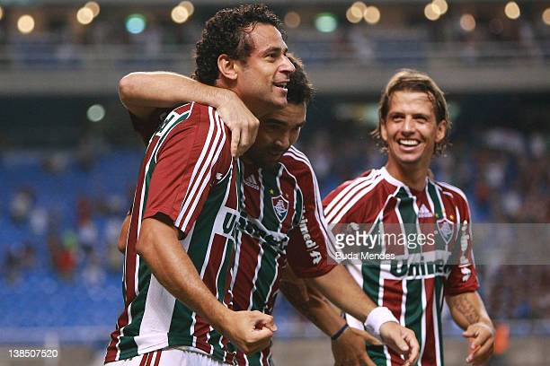 Fred Deco and Diguinho of Fluminense celebrates a scored goal against Arsenal FC during a match between Fluminense and Arsenal FC as part of...