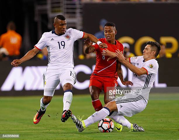 Fred Diaz and Daniel Torres of Colombia defend Andy Polo of Peru during a Quarterfinal match at MetLife Stadium as part of Copa America Centenario US...