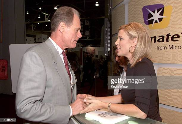 Fred Dryer and Vanna White at the Microsoft booth at the NATPE Convention in Las Vegas NV 1/23/01