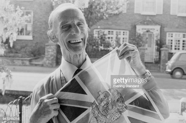 Fred English holding a British Flag with the Silver Jubilee logo UK 1st June 1977