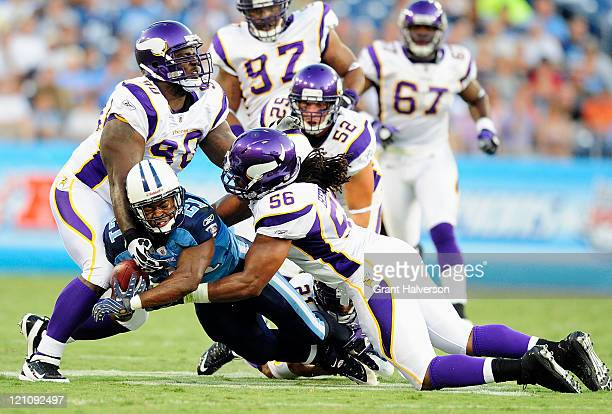 Fred Evans and E.J. Henderson of the Minnesota Vikings tackle Javon Ringer of the Tennessee Titans during a preseason game at LP Field on August 13,...