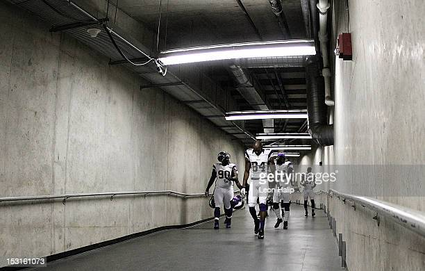Fred Evans Michael Jenkins Marvin Mitchell and Brandon Burton of the Minnesota Vikings walks to the fiel prior to the start of the game against the...