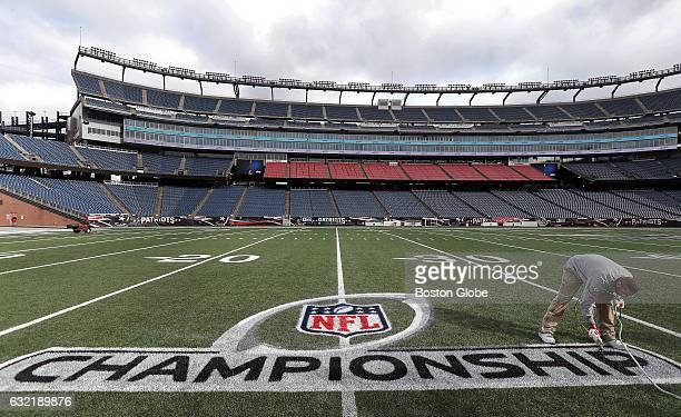 Fred Fletcher field superintendent applies the finishing touches to the logo at Gillette Stadium in Foxborough Mass on Jan 19 where the New England...