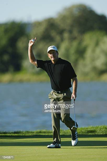 Fred Funk acknowledges the crowd after holing out on the 12th green during the third round on August 17 2002 for the PGA Championship at Hazeltine...