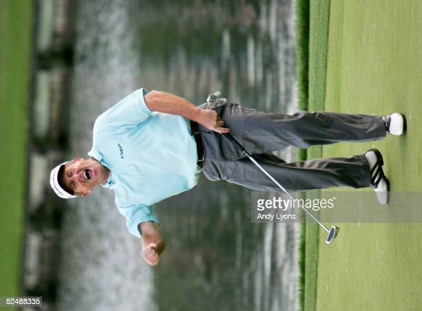 Fred Funk celebrates after making his par putt on the 18th hole during the final round of The Players Championship on March 28, 2005 at the TPC at...