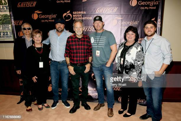 Fred Gretsch Dinah Gretsch artists Dallas Davidson John Berry Ben Hayslip Lena Thomas and Logan Thomas take photos backstage during the 6th Annual...