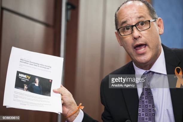 Fred Guttenberg father of Jaime Guttenberg age 14 who was killed at Marjory Stoneman Douglas High School holds up an article about a recent ad put...