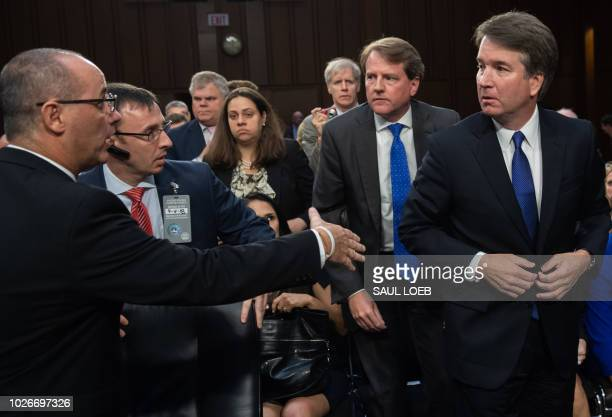 Fred Guttenberg father of Parkland Florida shooting victim Jaime Guttenberg tries to speak with Judge Brett Kavanaugh as he leaves for a break during...