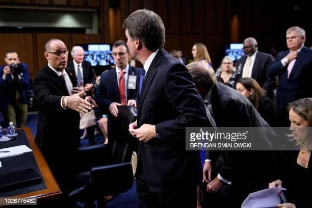 Fred Guttenberg father of Stoneman Douglas High School mass shooting victim Jaime Guttenberg peaches to shake the hand of Brett Kavanaugh during a...