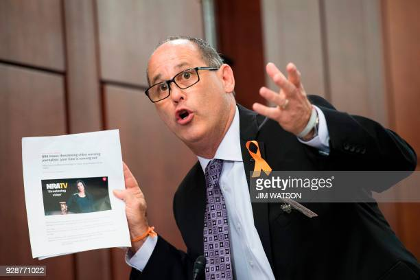 Fred Guttenberg the father of 14yearold Jaime Guttenberg who was killed at Stoneman Douglas High School in Parkland Florida holds up an print out of...