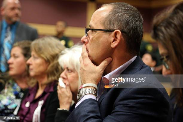 Fred Guttenberg watches as Nikolas Cruz enters the courtroom for his arraignment at the Broward County Courthouse March 14 2018 in in Fort Lauderdale...