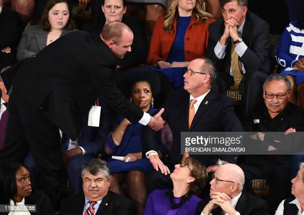 Fred Guttenberg, who lost his 14-year-old daughter in the Parkland, Florida, school shooting is removed after yelling during the State of the Union...
