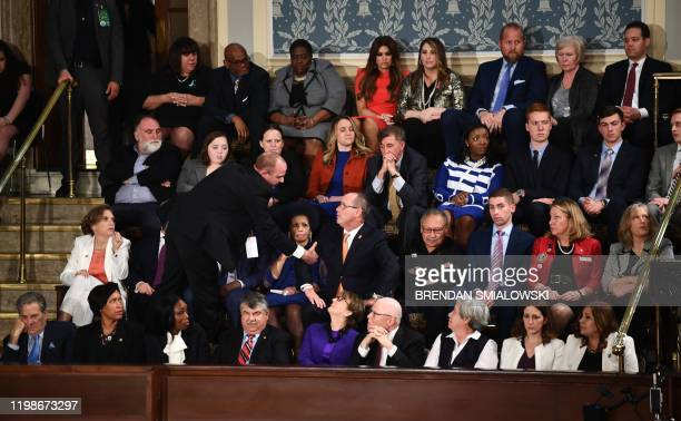 Fred Guttenberg, who lost his 14-year-old daughter in the Parkland, Florida, school shooting is removed by security after yelling as US President...
