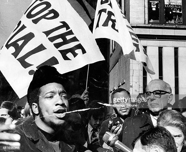 Fred Hampton left head of the Illinois Black Panthers and Dr Benjamin Spock right attend a rally against the trial of eight people accused of...