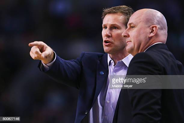 Fred Hoiberg head coach of the Chicago Bulls talks with assistant coach Jim Boylen during the second half at TD Garden on December 9 2015 in Boston...