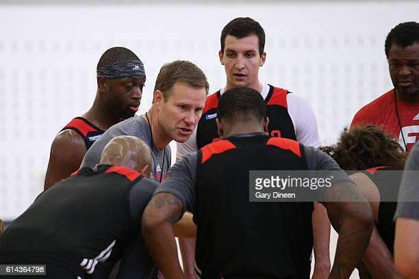 Fred Hoiberg of the Chicago Bulls huddles during the Chicago Bulls All Access practice on October 11 2016 at the Advocate Center in Chicago Illinois...