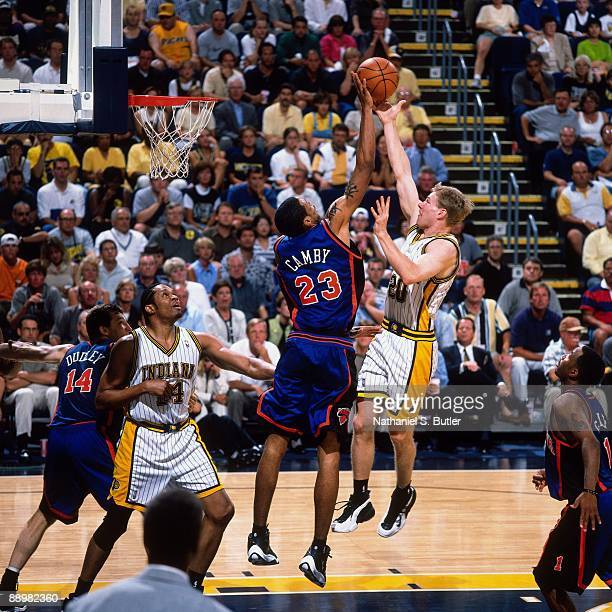 Fred Hoiberg of the Indiana Pacers has his shot rejected by Marcus Camby of the New York Knicks in Game Five of the Eastern Conference Finals during...