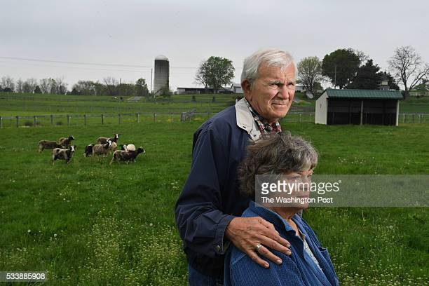Fred Horak and his wife Joan Horak pose for a portrait along with some of their Jacob sheep on their property on Wednesday May 11 2016 in Gettysburg...