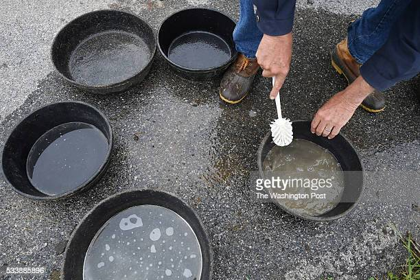 Fred Horak cleans food containers at his property on Wednesday May 11 2016 in Gettysburg PA Ever since he and his wife Joan Horak noticed...