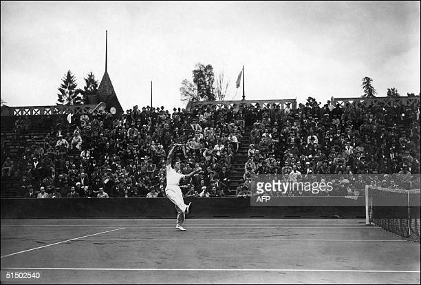 Fred J Perry of England returns a forehand to an unidentified opponent in the 1930's at the Roland Garros stadium in Paris Perry won the US Open...