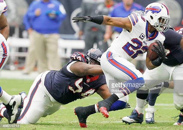 Fred Jackson of the Buffalo Bills breaks the tackle of Ryan Pickett of the Houston Texans in the second quarter in a NFL game on September 28, 2014...