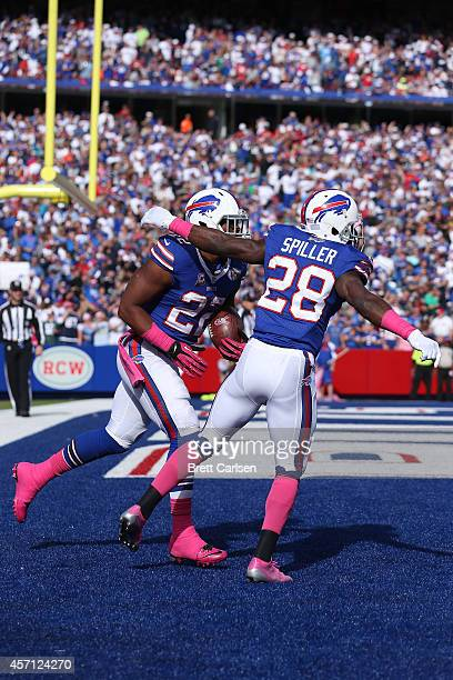 Fred Jackson of the Buffalo Bills celebrates a touchdown with CJ Spiller of the Buffalo Bills against the New England Patriots during the second half...