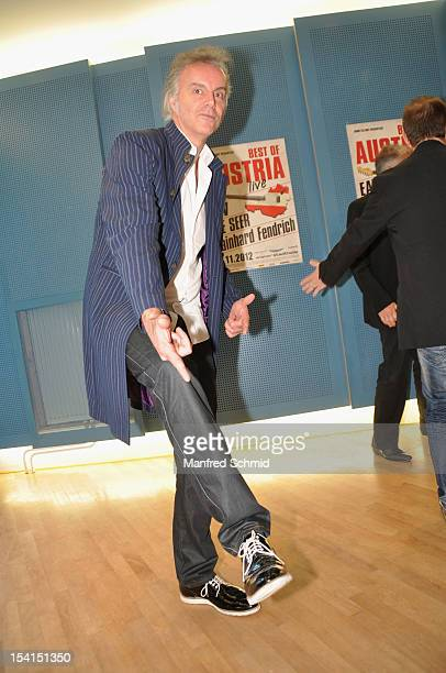 Fred Jaklitsch showing his shoes and attends a press conference to announce the November 2012 Die Seer Rainhard Fendrich And EAV tour 'Best Of...