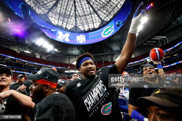Fred Johnson of the Florida Gators celebrates after his teams win over the Michigan Wolverines during the ChickfilA Peach Bowl at MercedesBenz...