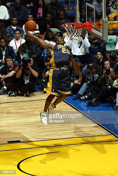 Fred Jones of the Indiana Pacers goes for a dunk during the Sprite Rising Stars Slam Dunk Competition on February 14 2004 at the Staples Center in...