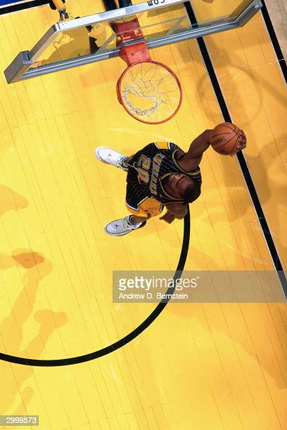 Fred Jones of the Indiana Pacers goes for a dunk during the Sprite Rising Stars Slam Dunk Competition on February 14, 2004 at the Staples Center in...