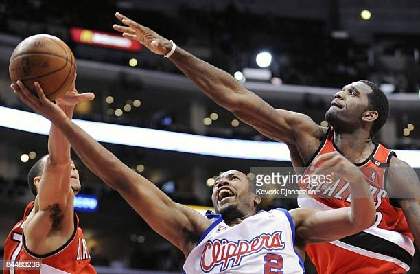 Fred Jones of the Los Angeles Clippers drives to the basket against the defense of Greg Oden of the Portland Trail Blazers at the Staples Center...