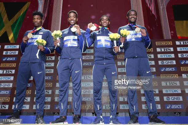 Fred Kerley Michael Cherry Wilbert London and Rai Benjamin of the United States stand on the podium for the medal ceremony after winning gold in the...