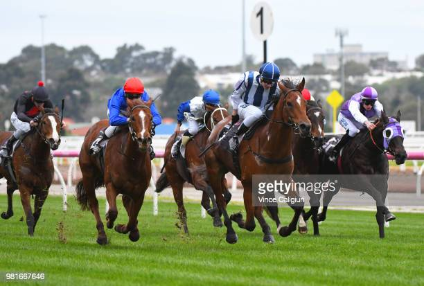 Fred Kersley riding Miles of Krishan defeats Ethan Brown riding Hussy's Glow in Race 2 during Melbourne Racing at Flemington Racecourse on June 23...