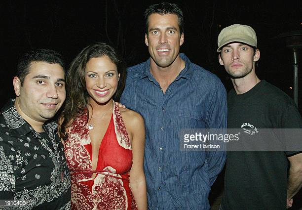 Fred Khalilian Jill Nicolini Kevin Gallaher and actor Brian Banks pose for a picture as they attend a party held at Ian Schrager's SkyBar at Mondrian...