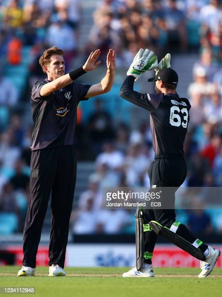 Fred Klaassen of the Manchester Originals celebrates with team mate Jos Buttler after taking the wicket of Sunil Narine of the Oval Invincibles...