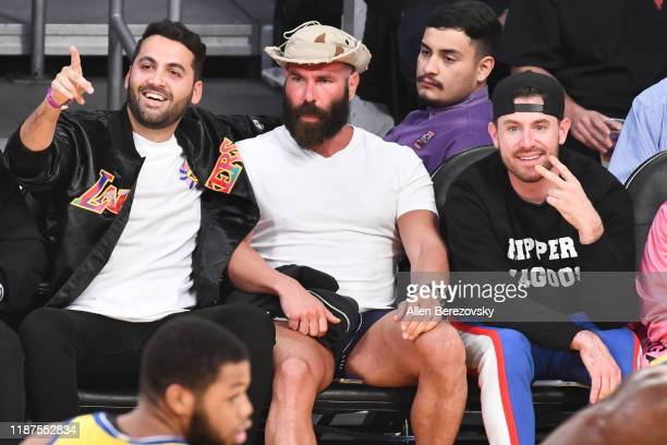 Fred Lameh Dan Bilzerian and Bob Menery attend a basketball game between the Los Angeles Lakers and the Golden State Warriors at Staples Center on...