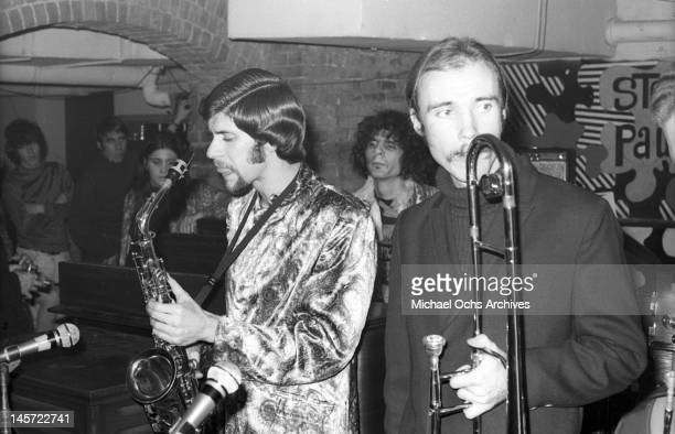 Fred Lipsius Al Kooper and Dick Halligan of the rock and roll band 'Blood Sweat And Tears' perform onstage at Steve Paul's The Scene nightclub on...