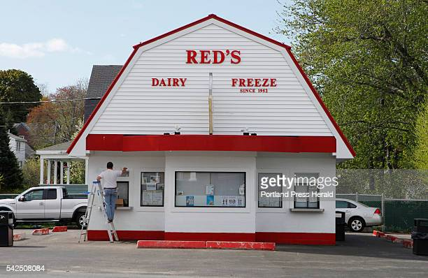 Fred Loonie of Londonderry NH paints window trim outside Red's Dairy Freeze Wednesday May 20 2015 in South Portland Maine