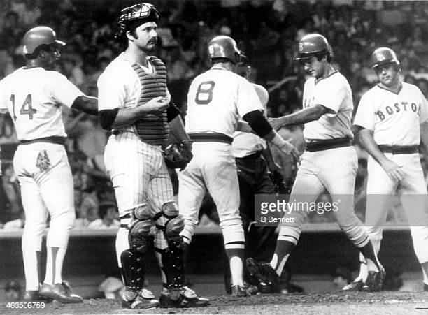 Fred Lynn of the Boston Red Sox is congratulated from his teammates Carl Yastrzemski, Jim Rice and Bob Bailey after hitting a three-run homerun as...