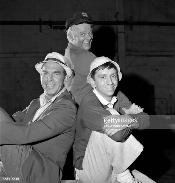 Fred MacMurray Alan Hale Jr and Bob Denver in a promo to announce the CBS television shows Gilligan's Island and My Three Sons on Thursday nights...