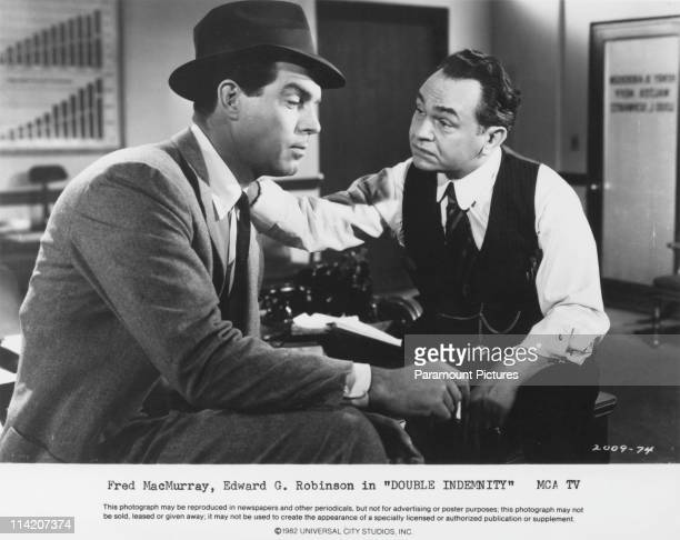Fred MacMurray and Edward G Robinson in a still from 'Double Indemnity' directed by Billy Wilder 1944