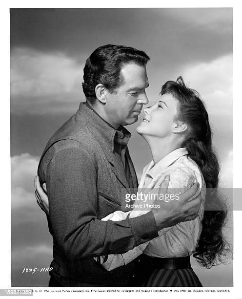 Fred MacMurray embracing Janice Rule in publicity portrait in a scene from the film 'Gun For A Coward' 1957