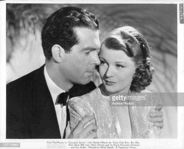 Fred MacMurray holding Harriet Hilliard in a scene from the film 'Cocoanut Grove' 1938