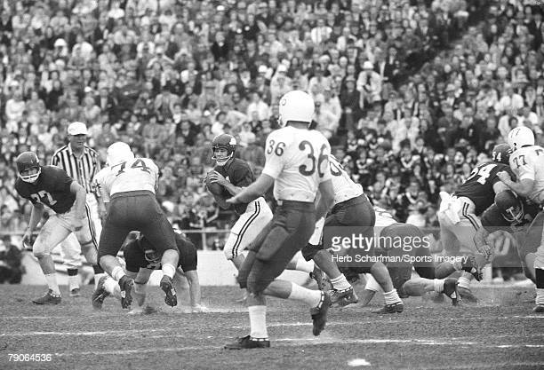 Fred Marshall of the Arkansas Razorbacks goes back to pass against the Nebraska Huskers during the 1965 Cotton Bowl on January 1 1965 in Dallas Texas