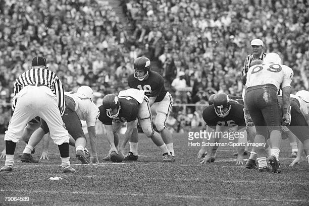 Fred Marshall of the Arkansas Razorbacks takes the snap against the Nebraska Huskers during the 1965 Cotton Bowl on January 1 1965 in Dallas Texas
