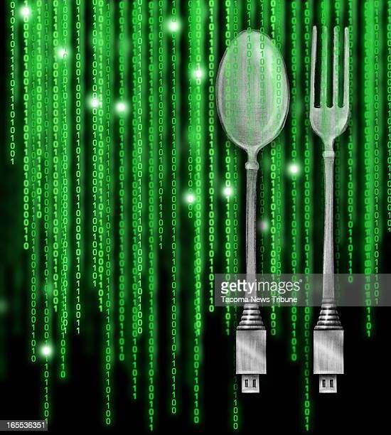 Fred Matamoros color illustration of fork and spoon with USB ports on handle against a backdrop of glowing green binary code The News Tribune...