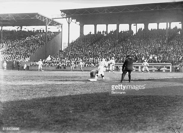 Fred Merkle of the Chicago Cubs is called out at third base during the 4th game of the 1918 World Series between the Chicago Cubs and the Boston Red...